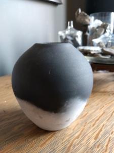 Jason Wesaw; black and white unglazed, hard-fired pottery