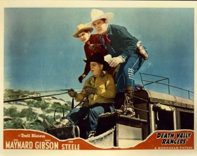 Old color movie card of cowboys on a stage coach