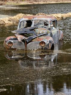 Old rusted truck in a river